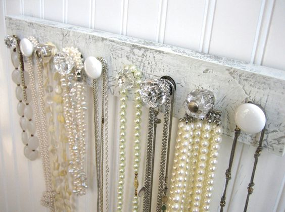 Color may not always be your thing, so this white and clear wall mounted jewelry organizer with nine knobs has a clean fresh look, and will keep your precious necklaces in order.