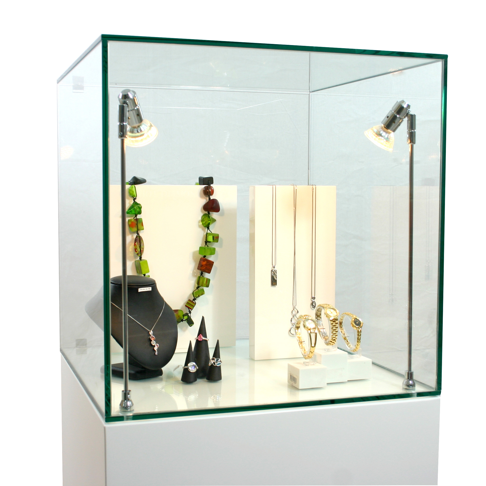 Jewelry and accessories display setting inside a 50 cm glass display case hire from Exhibition Plinths.
