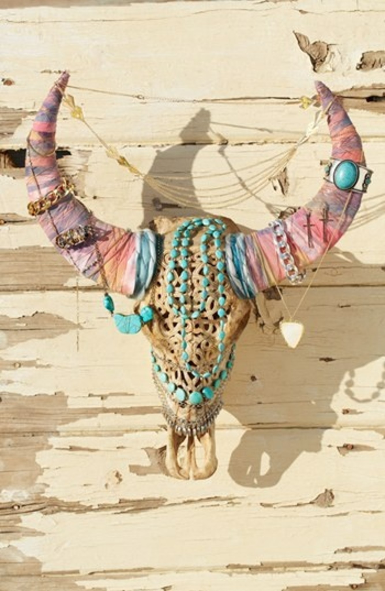 Animal skull with decorated horns used as an awesome jewelry display and jewelry storage ideas.