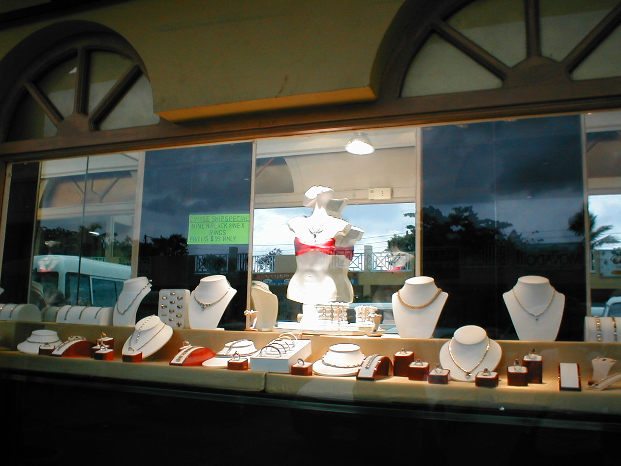 Various jewels such as necklaces, bracelets and rings displayed in a jewelry store window seen in Ocho Rios.