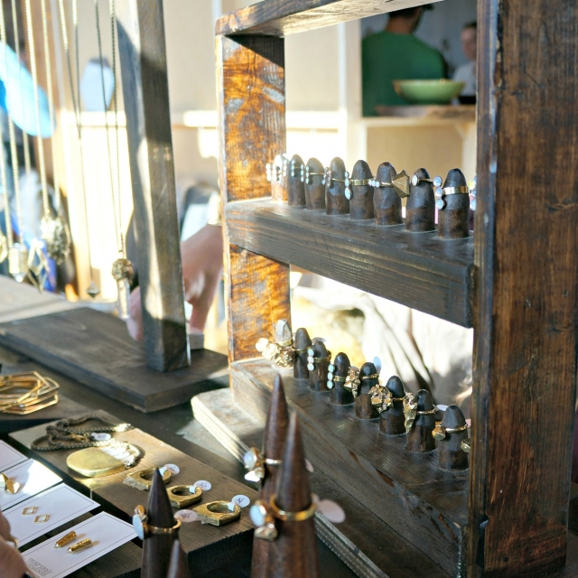 Craft booth with an original wooden piece for ring display and another wood piece for necklace hanging, vintage and retro jewelry display ideas.
