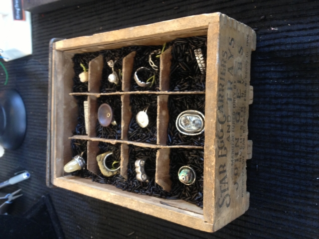 A vintage egg crate given a new purpose as a ring display and storage item, original retro jewelry display ideas.