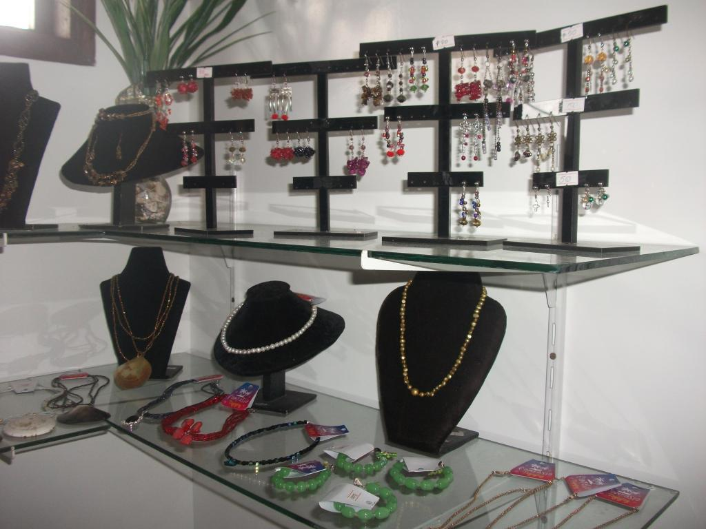 A more common approach for fashion jewelry display ideas, with classic black necklace holders and hangers for earrings.
