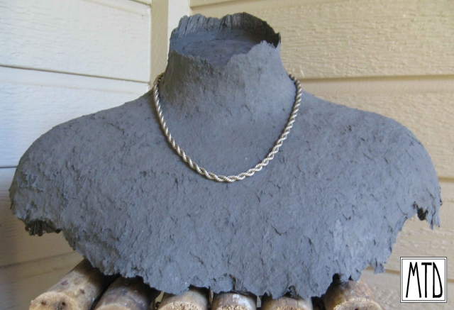 A medium bust piece with an unusual finish for fine jewelry display.