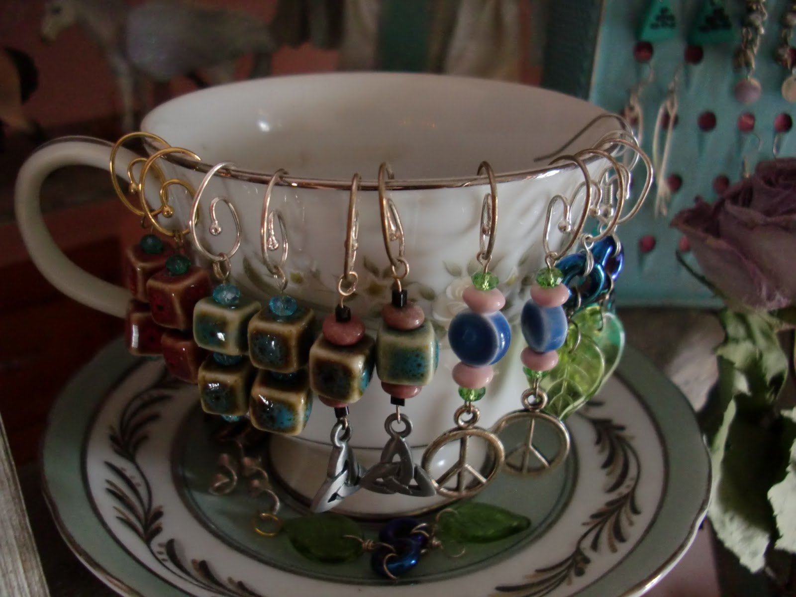 Original, yet simple and cute jewelry display ideas from a teacup used as an earrings hanger.
