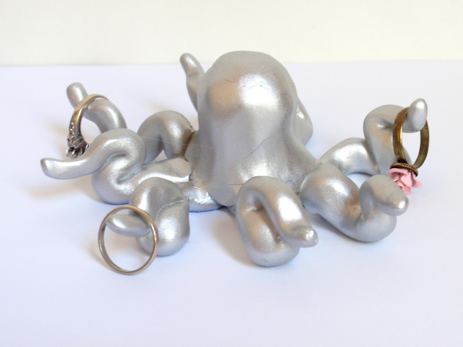 One of the cute ways to store your jewelry is with this silver shining octopus ring holder.