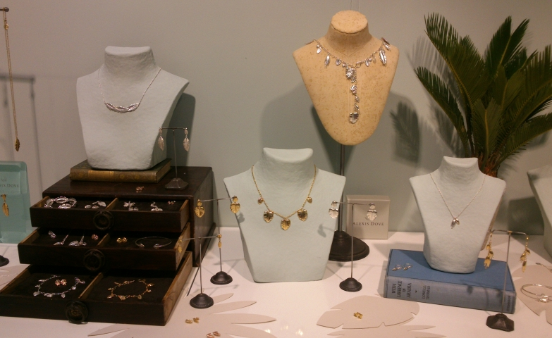 Jewelry stands display ideas with vintage jewelry box drawers and necklace holders placed on books.
