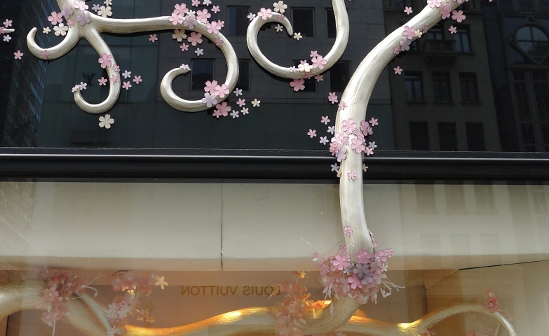Jewelry display ideas from the front and exterior display of Van Cleef and Arpel, using branches and cherry flowers as main decoration.