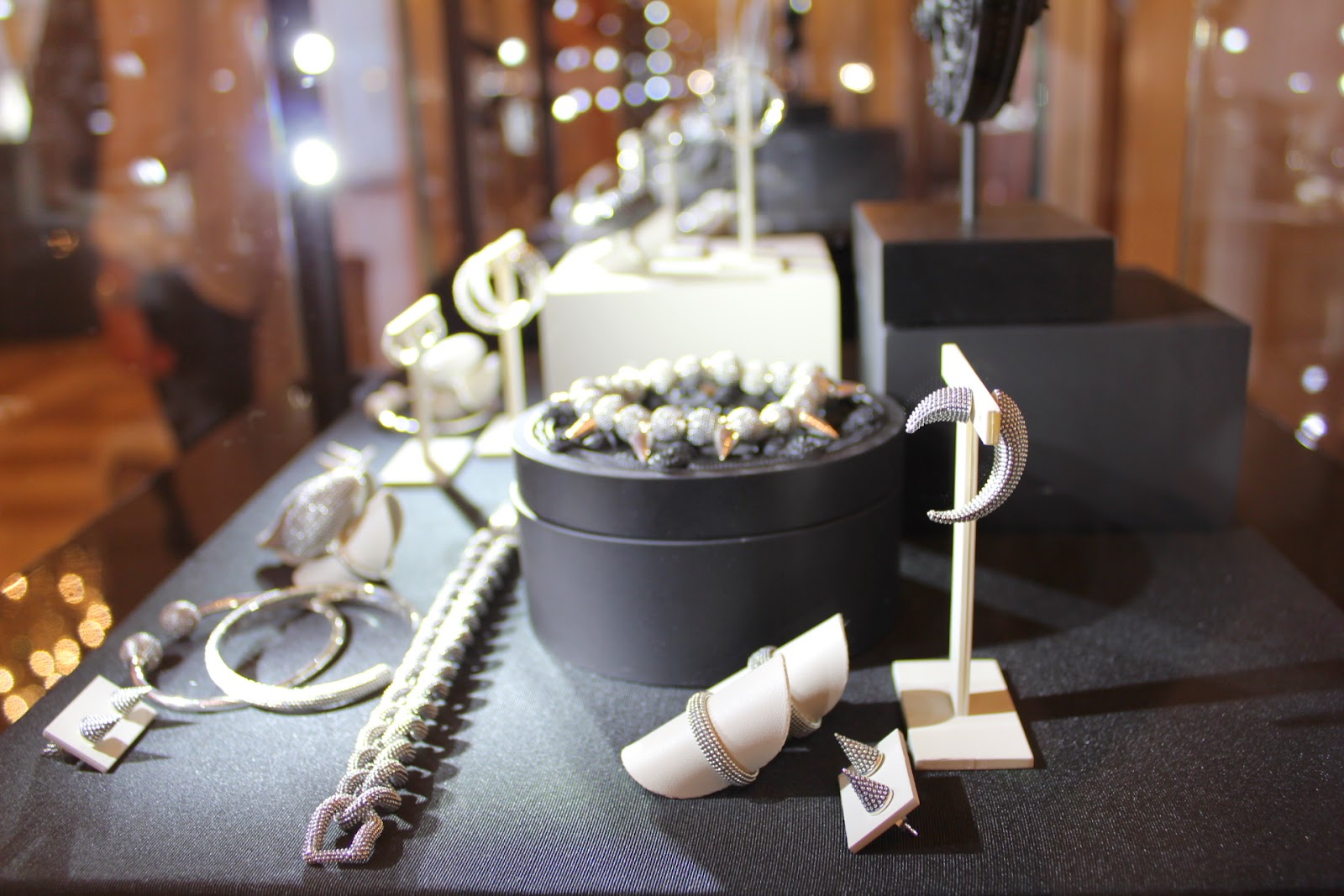 Close up on a jewelry display, simple minimalist design and discrete holders, hangers and stands for the most delicate jewels.