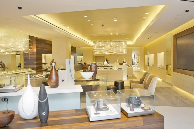 For large spaces you can use all kinds of jewelry displays and imaginative designs, like glass boxes, armoires and different organizers.