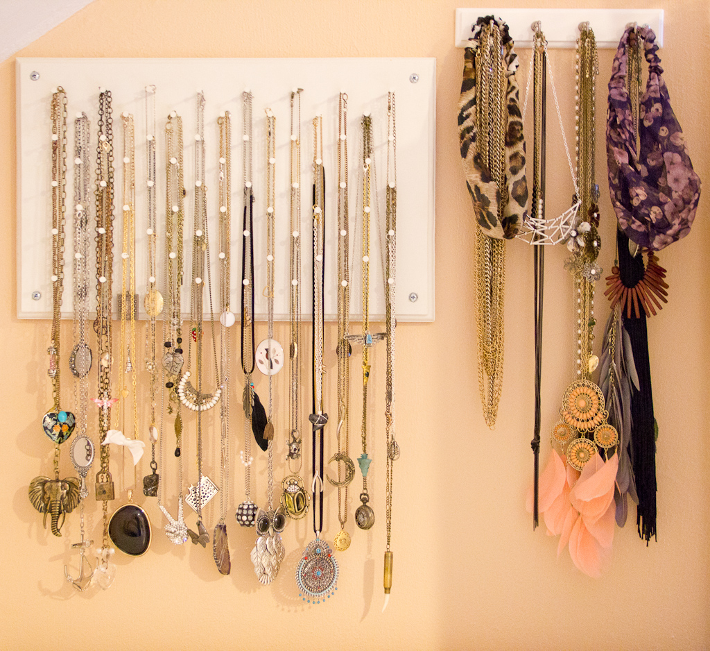 Wall mounted jewelry hanger mainly for necklace storage, but can also be used to hang headbands.