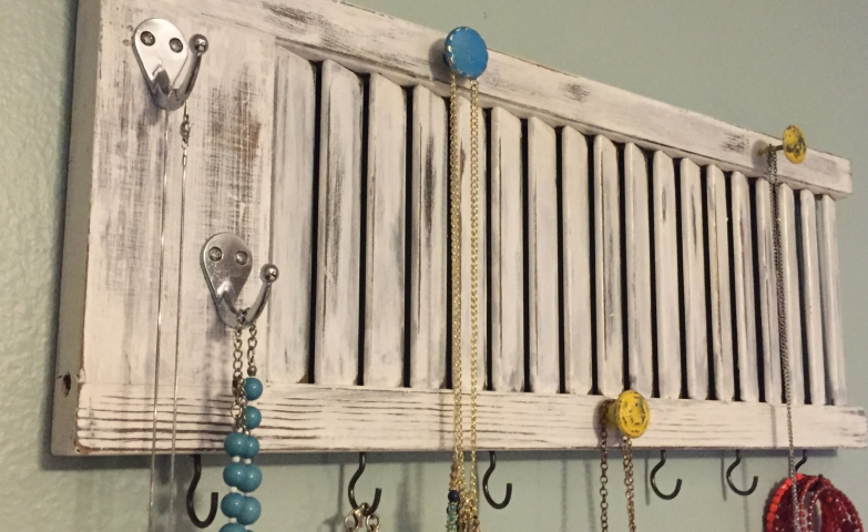 One of the popular items for jewelry storage is this vintage holder display with knobs for hanging necklaces and bracelets.