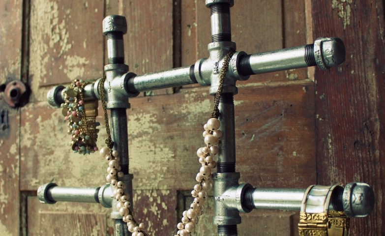 Original storage and display solution with racks for bracelets and even for necklace hanging, made from metal pipes.