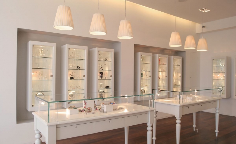300 creative jewelry display ideas designs zen merchandiser jewelry display interior design with suspended lamps white glass display stands and white display cabinets solutioingenieria Images