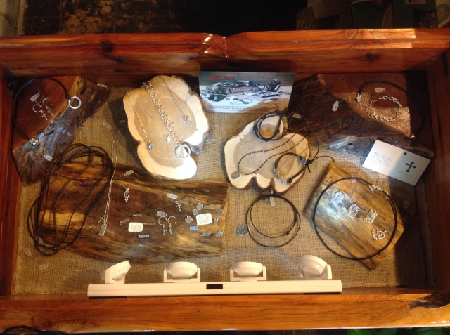 Handcrafted furnishings using wood props to create a rustic jewelry display setting.