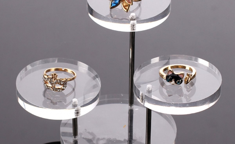 Delicate glass stands on different levels which can be used to display original and unique rings just like these.