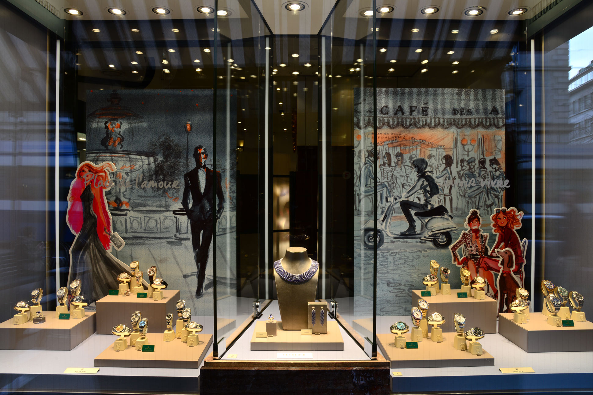 Window display with an elegant theme for Bucherer Jewelry in Zurich, jewelry display setting created by Studio Achermann, Graphic Design.