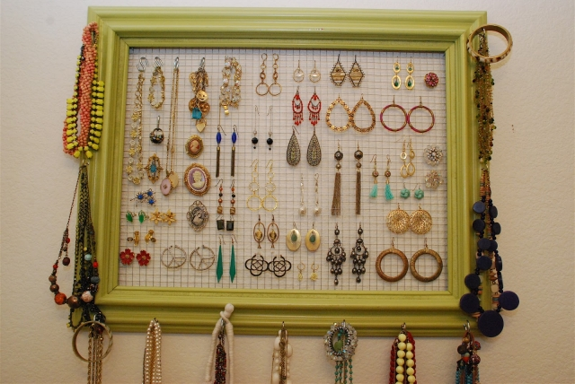 Another vintage jewelry holder made from a picture frame for hanging earrings and necklaces.