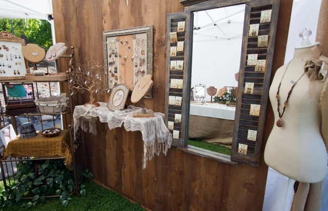 Terra Rustica lives up to its name when creating a jewelry display booth. They use many natural and rustic decor and find creative ways to display their merchandise.