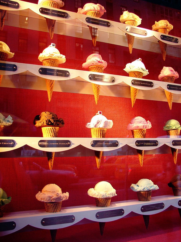 Tasty jewelry display idea by American Apparel for its Summer window display with delicious ice cream cones.