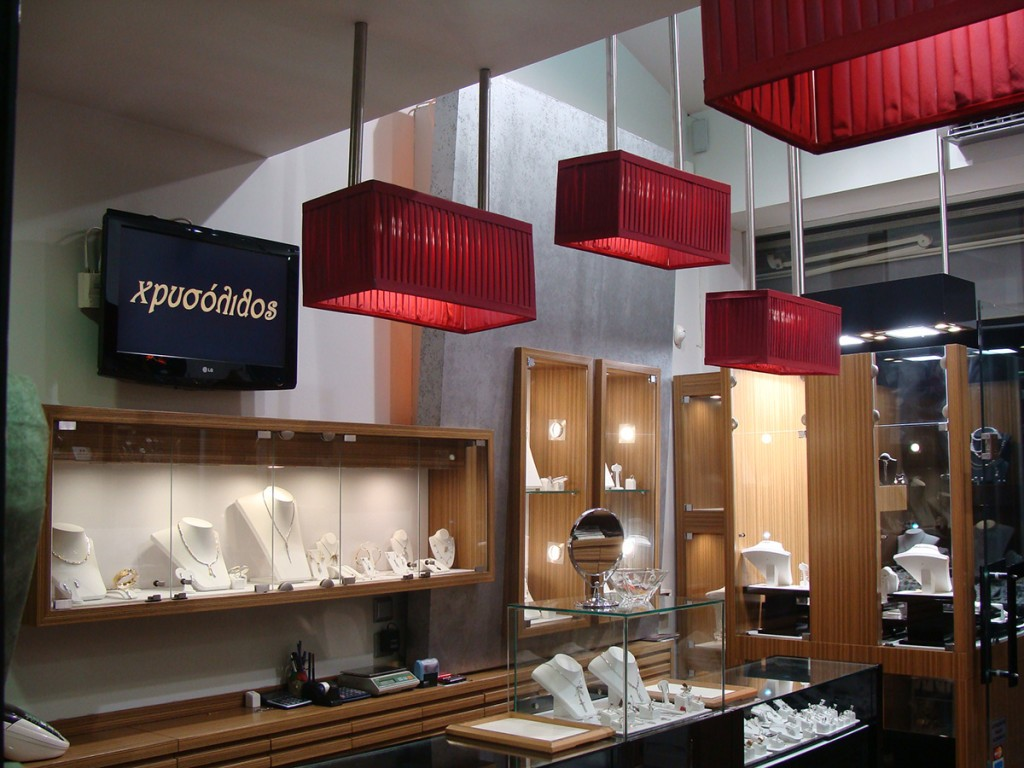 Red rectangular lamps really add a special look to this jewelry store's interior design.