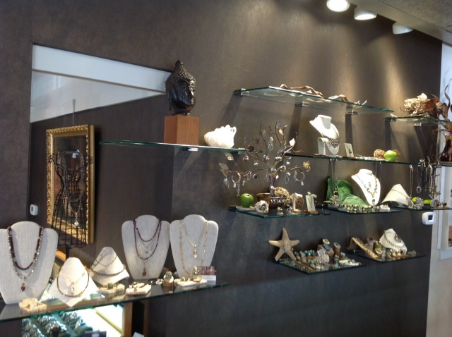 Interior decoration and setting, with glass stands and seaside themed decor from a jewelry store in Zionsville.
