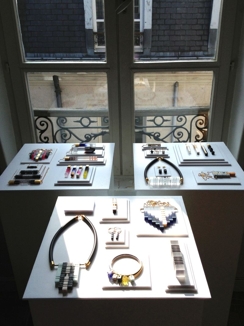 A white flat jewellery display in front of a window showing to the exterior, jewelry display ideas inspiration.