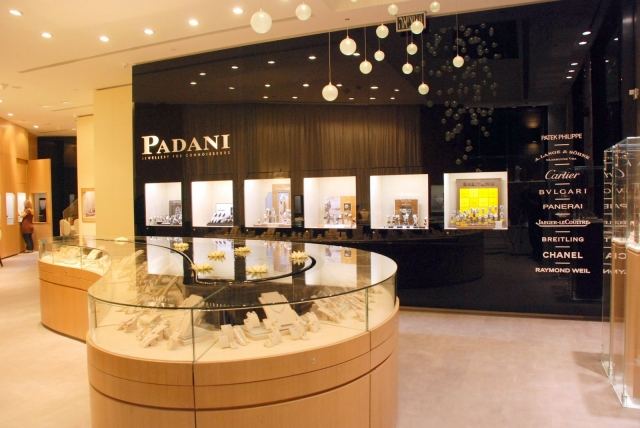Modern interior design and small hanging lamps inside the Padani jewelry shop.