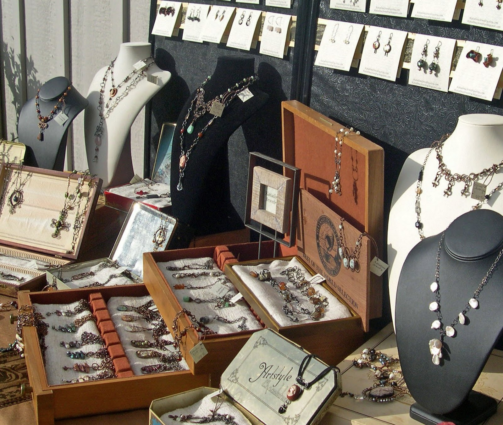 Various jewelry boxes and necklace holders used for jewelry display by Katalina Jewelry.