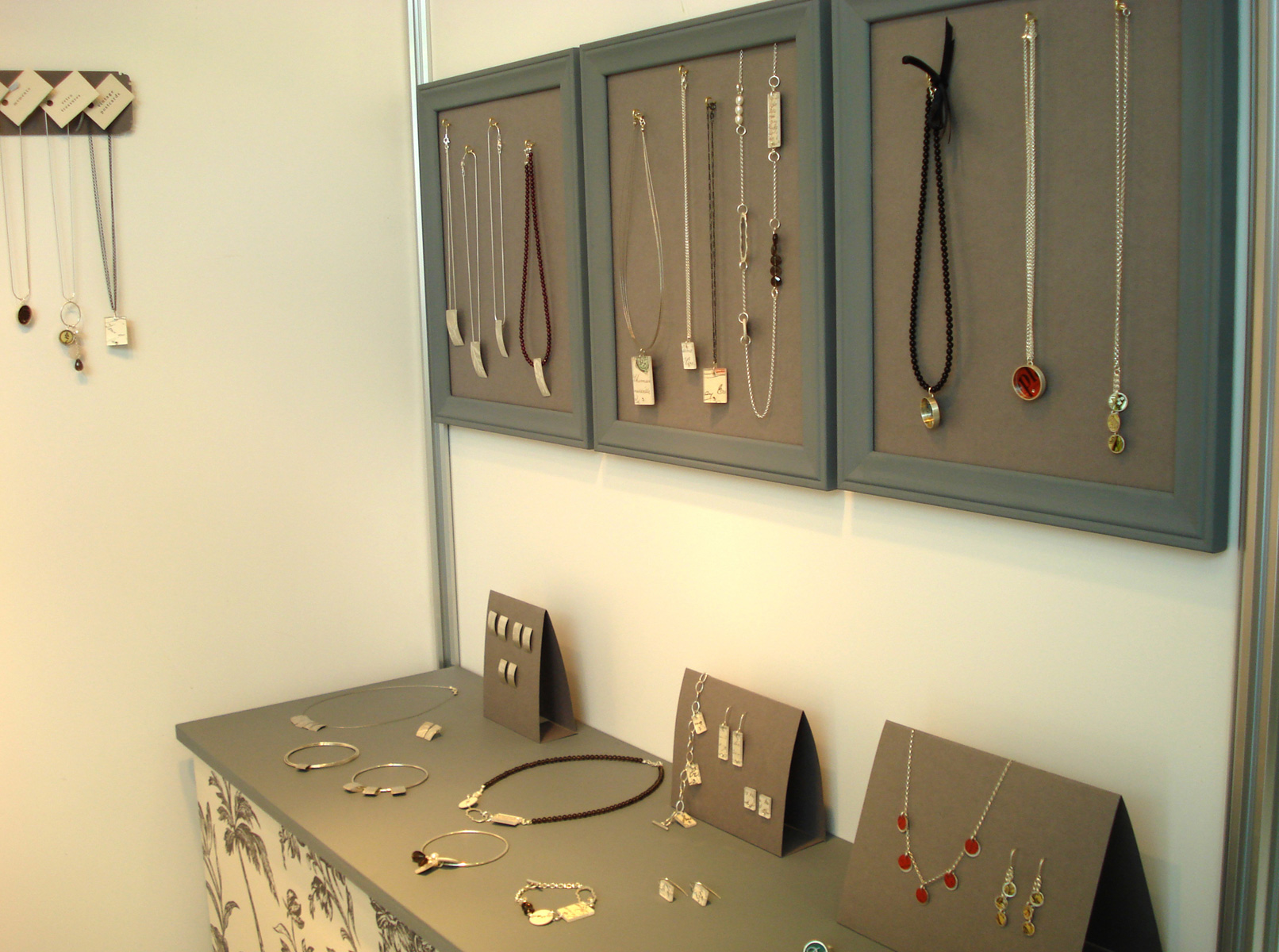 Miranda Hughes Jewellery crated a simple setting for this display using frames, cardboard and a display table to show off the merchandise.