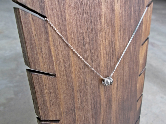 Modern jewelry display ideas for home with this wooden necklace hanger, also perfect for a store display or visual merchandising setting.