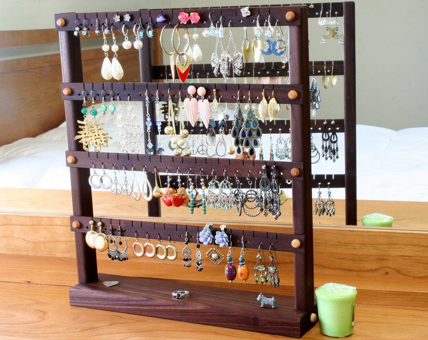 Modern jewelry display ideas for earrings hung on wooden display hangers.