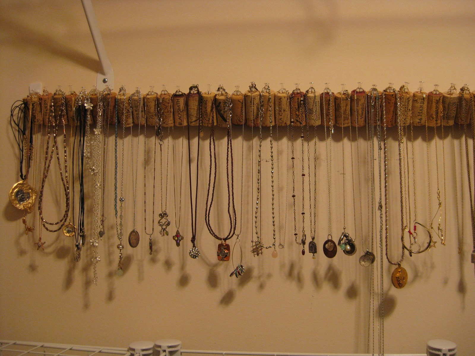 Using bottle corks with hooks in them is a new fun way to display your jewelry.