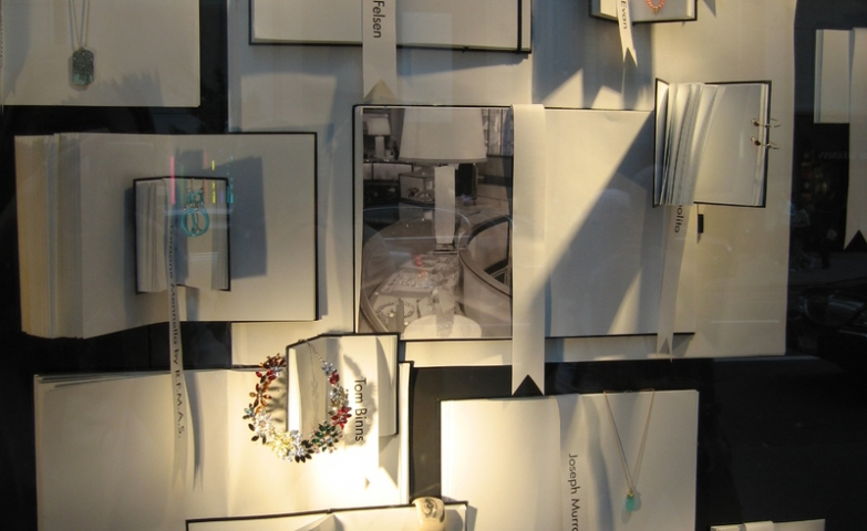 Plenty of empty notebooks used for a Christmas shop window display in London, great jewelry display ideas and inspiration.