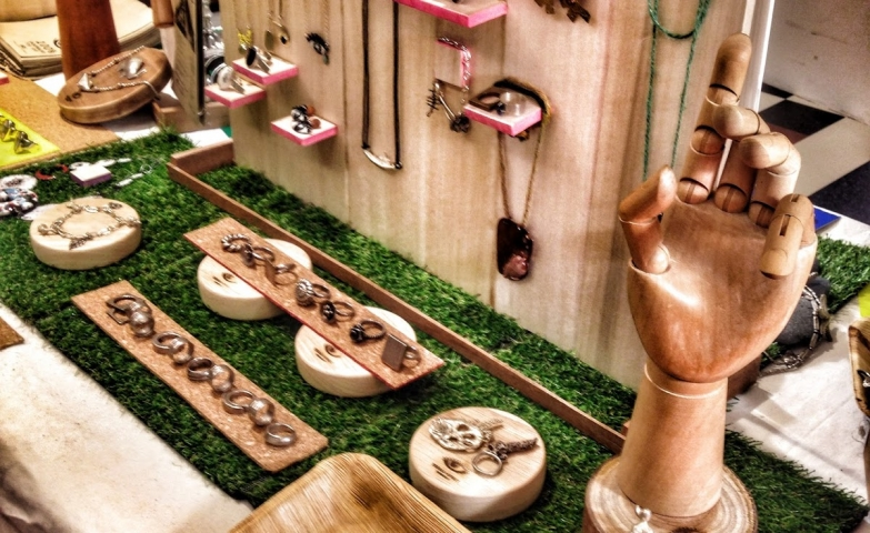 Going all natural with natural wood display props and a piece of artificial grass to create a pop-up store display.