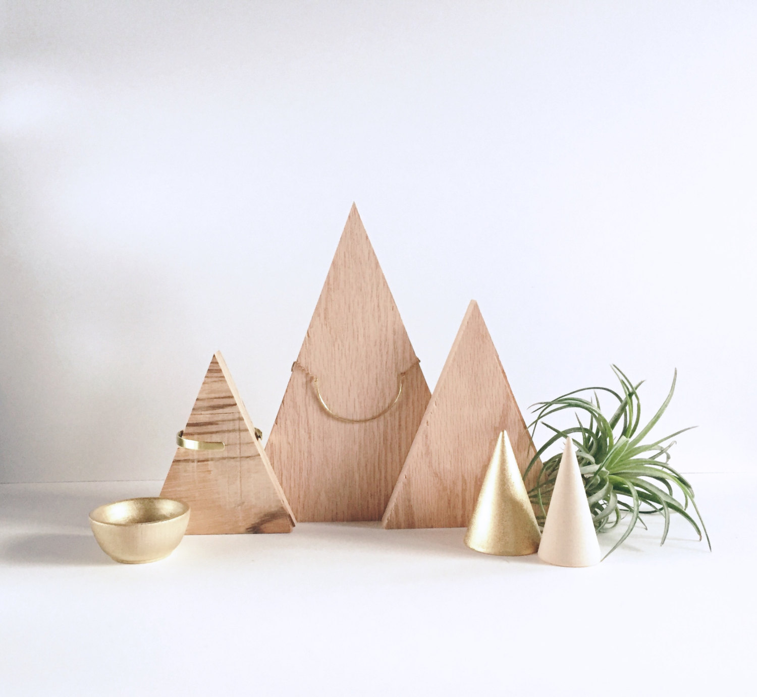 Wood triangle, a minimal and popular design for necklace storage and jewelry display. A creative storage and organization idea.