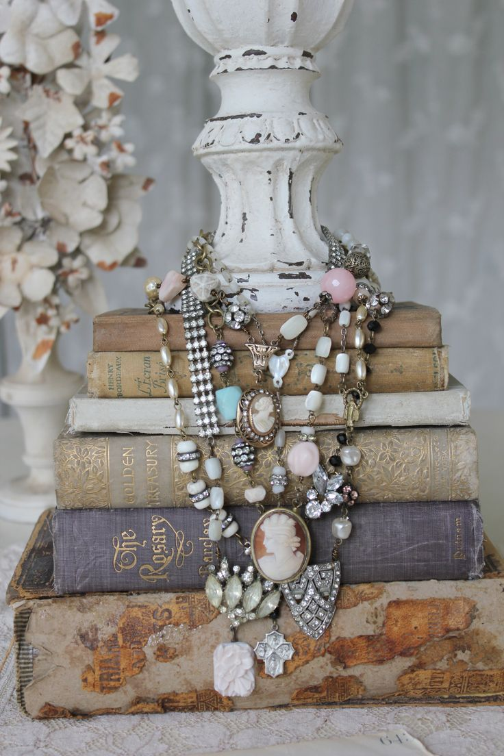 Jewelry display ideas for a craft show display booth, easy to make with a few vintage books and an antique looking vase to put those necklaces around it.