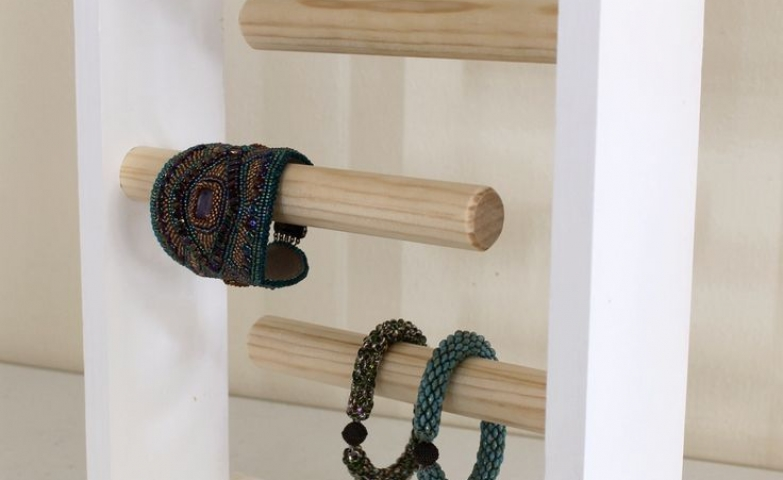 Creative ideas for jewelry display, especially for craft booths. A bracelet holder with three wooden racks.