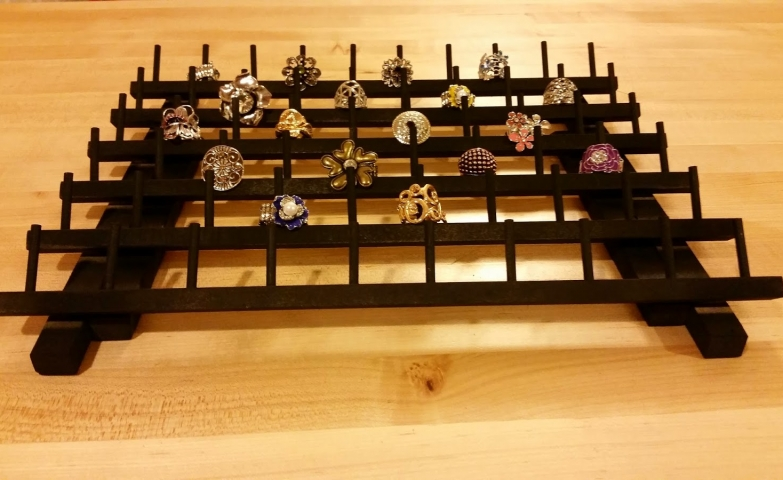 A piece especially made for ring display and storage, made as rows of hangers for rings. Ideas for your jewelry display.