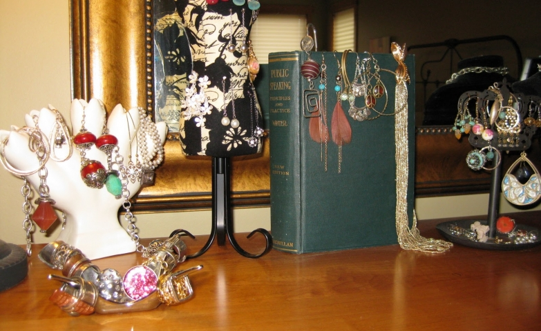Several vintage jewelry display options like old books, bust hangers and holders for different jewels.
