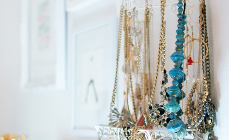 A diy jewelry display and jewelry storage ideas to hang necklaces next to your makeup and other beauty rituals.