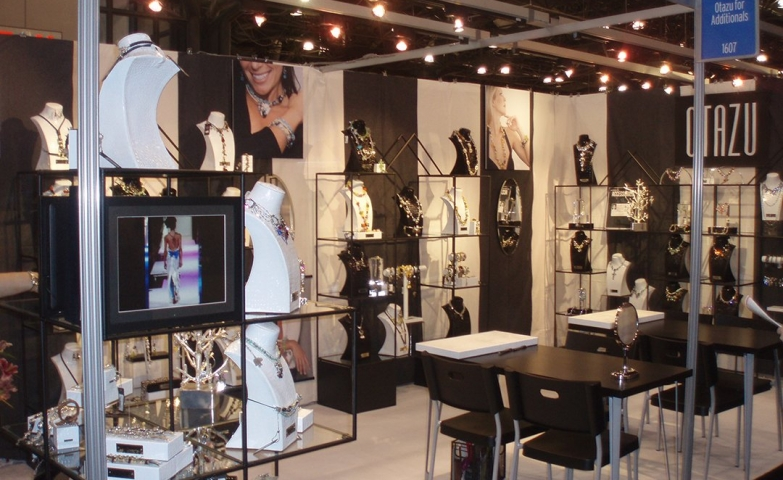 Otazu jewelry stand design for a tradeshow, managed to combine display with tables for customer service.
