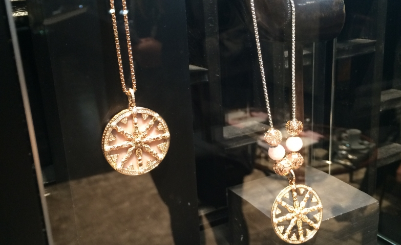 Big round pendants with original design make a set with the rings below them, inspiration ideas for fashion accessory jewelry display.
