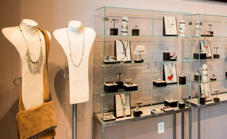 UNOde50 in store jewelry displays with glass stands and bust necklace holders, in Chesterfield.