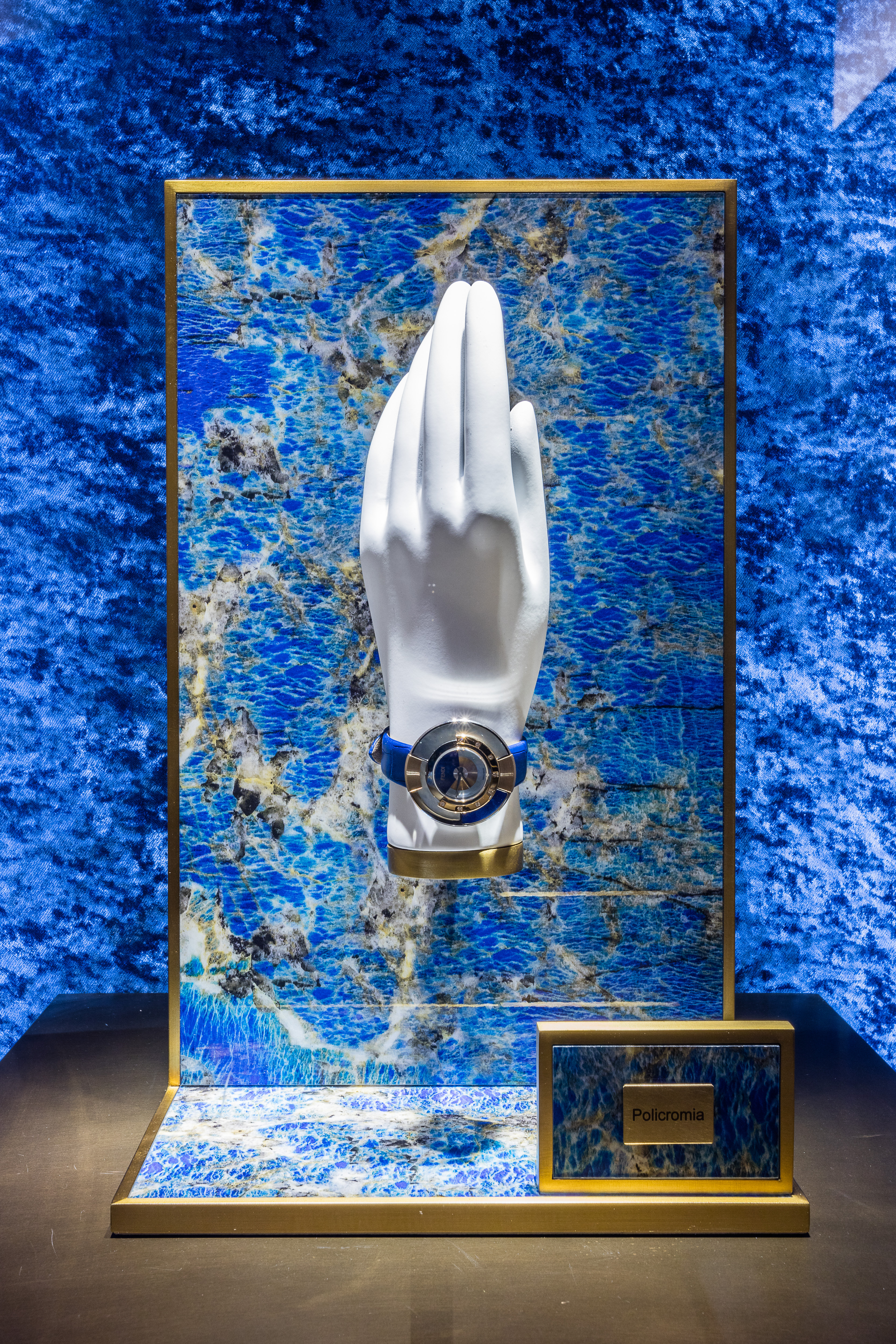 Fendi collection entitled Policromia and the unique display setting created for the jewelry display. Although simple, the strong blue makes all the difference.