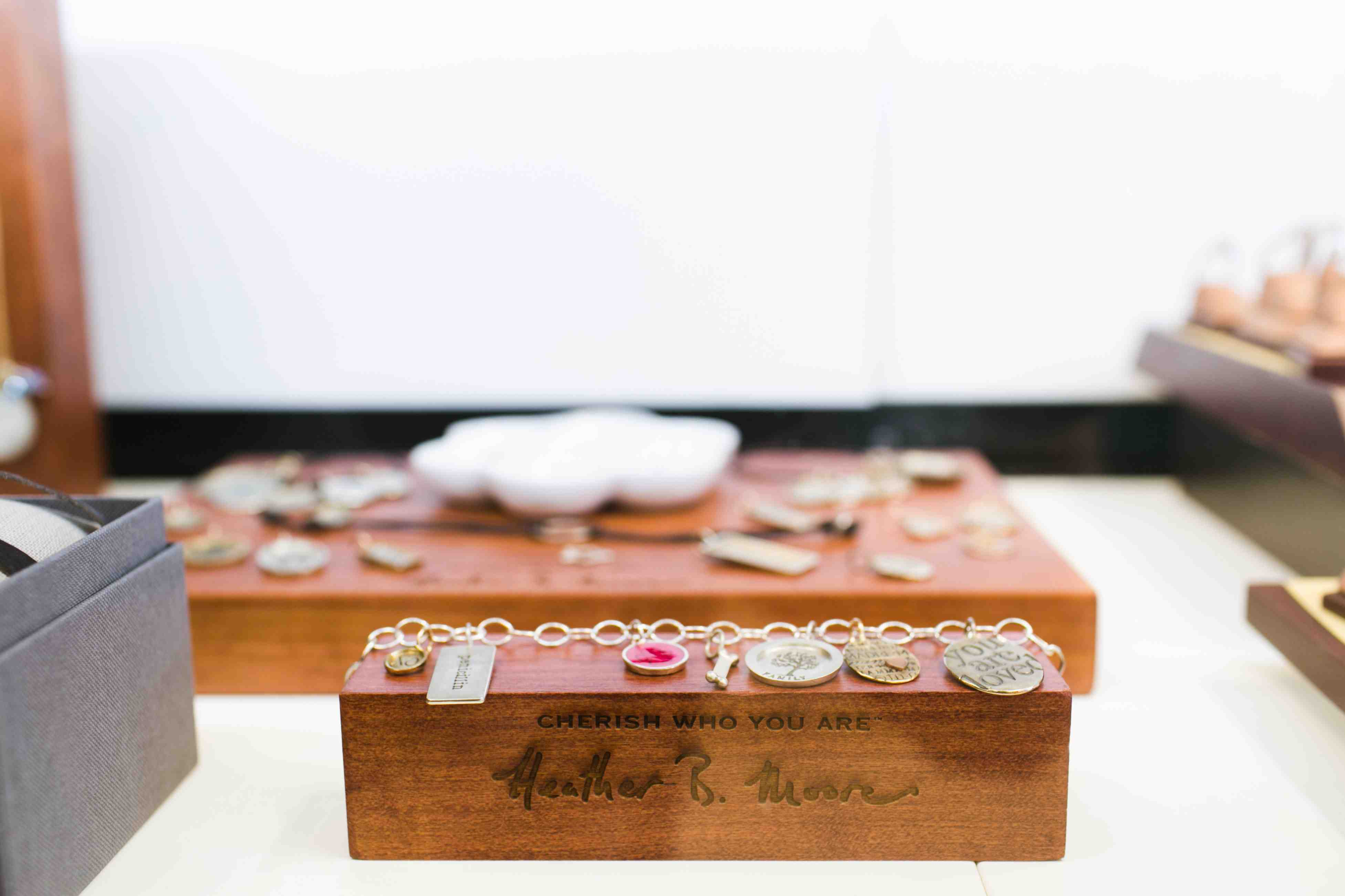 Jewelry display ideas for beautiful, delicate bracelets with small symbolic pendants on it.