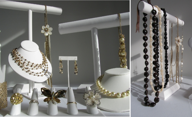 White jewelry displayers for shows together such as bracelet racks, necklace holders, ring holders, earring hangers.