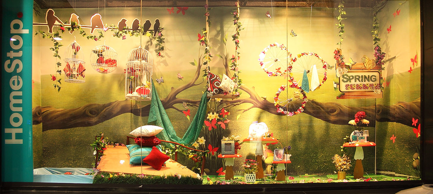 A fantasy land with many details that just puts you right in the setting, window displays for spring.
