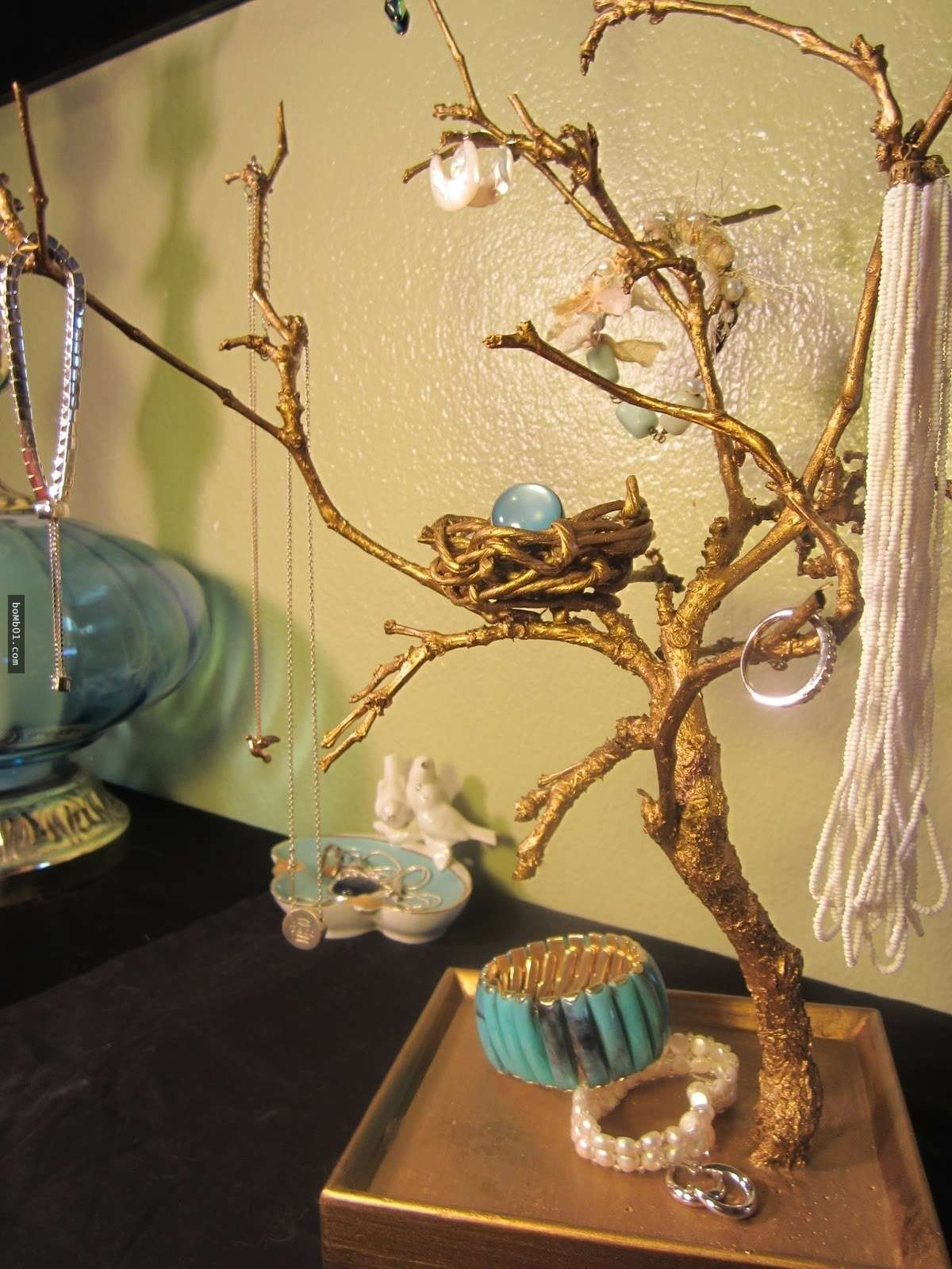 Jewelry display ideas on how to use a tree branch as a jewelry organizer, jewelry storage and jewelry display piece.