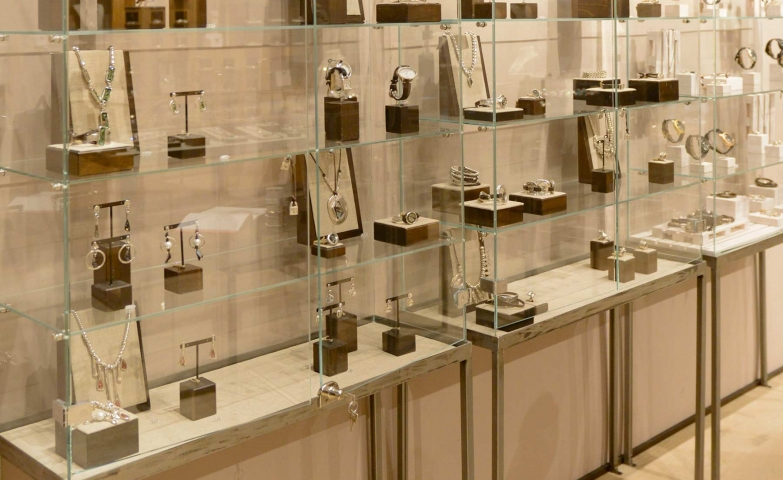 Engagement jewelry display in big glass box stands, for more inspirations on jewelry display ideas.